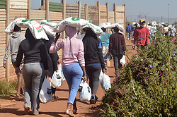 South Africa - Coronavirus - Pretoria - 20 May 2020 - Meal SA and their partners distributing food parcels and sanitizers to residents of Itireleng informal settlement near Laudim.<br /> Picture: Oupa Mokoena/African News Agency (ANA)