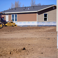 A soil roller preps a lot at the Navajo Housing Authority site near Ramah Tuesday.