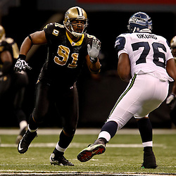 November 21, 2010; New Orleans, LA, USA; New Orleans Saints defensive end Will Smith (91) rushes against New Orleans Saints center Jonathan Goodwin (76) during the second half at the Louisiana Superdome. The Saints defeated the Seahawks 34-19. Mandatory Credit: Derick E. Hingle