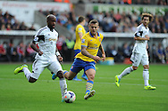 Swansea city's Dwight Tiendalli goes past Arsenal's Jack Wilshere. Barclays Premier league, Swansea city v Arsenal at the Liberty Stadium in Swansea on Saturday 28th Sept 2013.  pic by Andrew Orchard, Andrew Orchard sports photography.