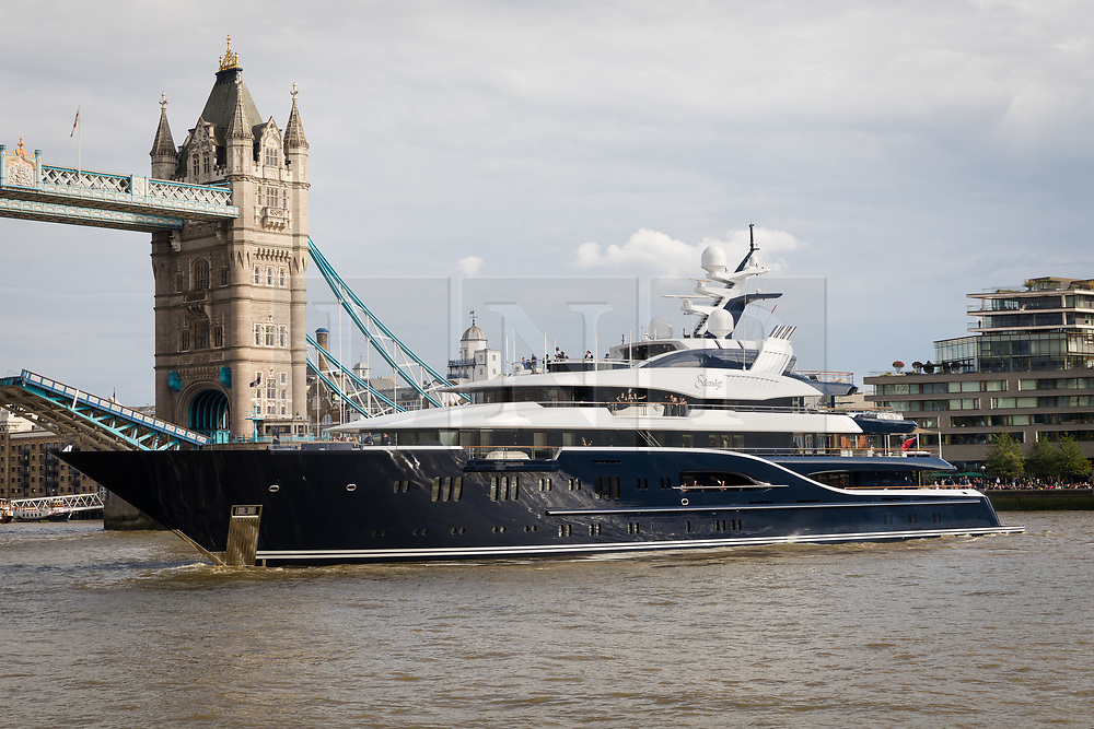 © Licensed to London News Pictures. 09/06/2019. London, UK.  The luxury 279 feet long (85 metre) superyacht Solandge arrives in London on the River Thames under Tower Bridge this evening before turning around and is the first superyacht to visit the pool of London in the capital this year.  Superyacht Solandge is believed to have originally been built for the Russian billionaire Alexander Girda in 2013, superyacht Solandge is now rumoured to be owned by a Saudi Royal after being sold in 2017 for a reported EUR155m in the biggest yacht brokerage deal of 2017. Solandge is available for charter with rates starting from over EUR1m plus expenses per week and has numerous luxuries onboard including an outdoor cinema and nightclub with DJ deck, indoor and outdoor gyms, dive centre, tender garage, sauna, swimming pool, bar with Bechstein piano and has accommodation for 16 guests in eight elegant staterooms..  Photo credit: Vickie Flores/LNP