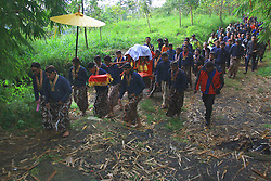 April 17, 2018 - Yogyakarta, Special Region of Yogyakarta, Indonesia - Hundreds of Yogyakarta palace servants known as Abdi Ndalem held procession Labuhan or Larungan Merapi at the foot of Mount Merapi Yogyakarta. They brought offering of some kind of heirlom cloth of Sultan Yogyakarta Palace and food in the form of rice and chicken meat pieces. (Credit Image: © Devi Rahman/Pacific Press via ZUMA Wire)