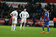 Jack Cork (24) and Federico Fernandez of Swansea city look on dejected at the final whistle after their team can only manage a 1-1 draw. Barclays Premier league match, Swansea city v Crystal Palace at the Liberty Stadium in Swansea, South Wales on Saturday 6th February 2016.<br /> pic by Andrew Orchard, Andrew Orchard sports photography.