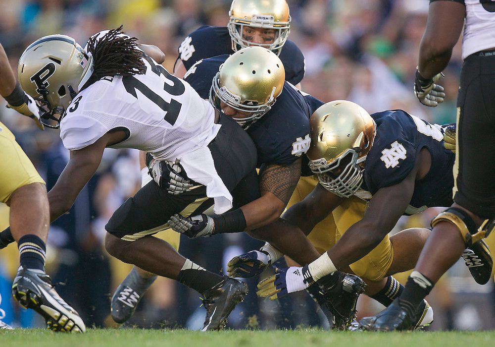 September 08, 2012:  Notre Dame inside linebacker Manti Te'o (5) tackles Purdue wide receiver Antavian Edison (13) during NCAA Football game action between the Notre Dame Fighting Irish and the Purdue Boilermakers at Notre Dame Stadium in South Bend, Indiana.  Notre Dame defeated Purdue 20-17.