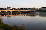 Chateau de Saumur along the river. The bridge. Saumur, Loire, France