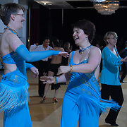 Same-sex ballroom dancers Jo Vaughan, center right, of Hertfordshire, England, and .Julia Smailes, left, of London, England, compete in the women's latin competition at the 5 Boro Dance Challenge on May 5, 2007...The locally produced 5 Boro Dance Challenge, New York City's first major same-sex dance competition, was held at the Park Central Hotel in Manhattan from May 4-6, 2007. .