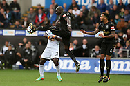 Mohamed Diame of Newcastle Utd raises his foot high as he gets the ball ahead of Wilfried Bony of Swansea city. Premier league match, Swansea city v Newcastle Utd at the Liberty Stadium in Swansea, South Wales on Sunday 10th September 2017.<br /> pic by  Andrew Orchard, Andrew Orchard sports photography.