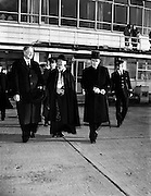 """Archbishop Godfrey leaving for London - for Catholic Herald .05/12/1958 ..William Godfrey (1889-1963) was an English Cardinal of the Roman Catholic Church. He served as Archbishop of Westminster from 1956 until his death, and was elevated to the cardinalate in 1958..William Godfrey was born in Liverpool to George and Mary Godfrey. His father was a haulage contractor. He leaned towards the priesthood from an early age, never taking another career into serious consideration. After studying at Ushaw College, Durham, and the English College, Rome, he was ordained on 28 October 1916 in Rome. He then finished his studies in 1918, obtaining his doctorates in divinity and philosophy in 1917, and did pastoral work in Liverpool until 1919. He taught Classics, Philosophy and Theology at Ushaw from 1918 to 1930, the year when he was raised to the rank of Domestic Prelate of His Holiness (28 October), with the title of monsignor, and appointed rector of the English College. At the College, the strict priest was known to his students as """"Uncle Bill"""". In 1935, Godfrey was made a member of the Pontifical Commission to Malta, and he was in official attendance at the 1937 coronation of King George VI..On 21 November 1938, he was appointed Titular Bishop of Cius and first Apostolic Delegate to Great Britain, Gibraltar and Malta. Godfrey, who was the first papal representative to England since the Reformation,[4] received his episcopal consecration on the following 21 December from Cardinal Raffaele Rossi, OCD, with Archbishop Luigi Traglia and Bishop Ralph Hayes serving as co-consecrators, in the chapel of the English College. He was also chargé d'affaires of the Holy See to the Polish government-in-exile in London in 1943, and was made Archbishop of Liverpool on 10 November 1953..Pope Pius XII named Godfrey as Archbishop of Westminster, and thus the ranking prelate of the Catholic Church in England and Wales, on 3 December 1956. During his installation, Godfrey condemned Communis"""
