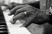 A blues and jazz pianist's hands while playing the keys.