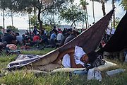 A Central American migrant sleeps at the park near Boulevard Adolfo López Mateos a day before their departure to Tijuana, Mexico in hopes of seeking asylum in the US. On November 19th, 2018 in Mexicali, Mexico.