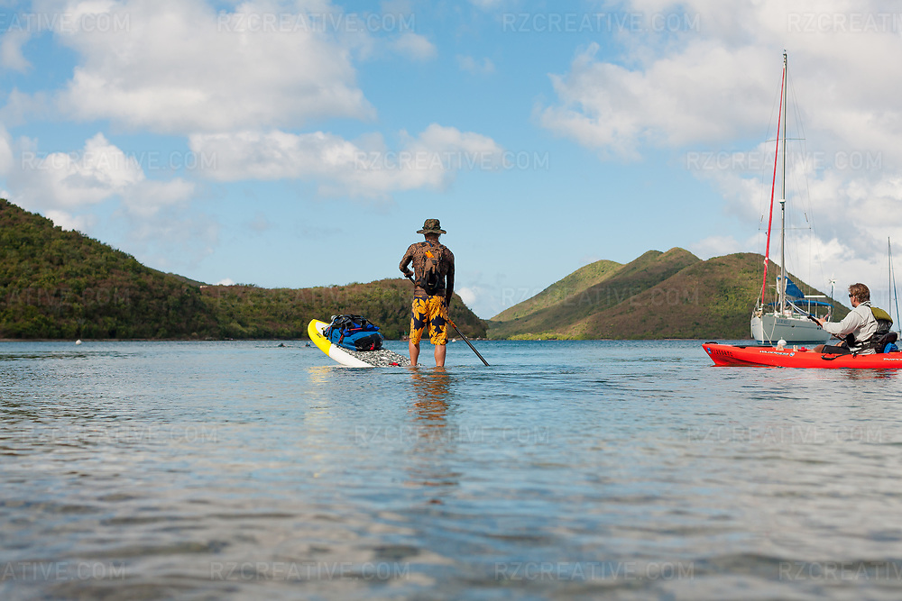 Ted Rutherford and Mark Anders paddling around the island of St. John in the United States Virgin Islands. Tortola can be seen in the background. Photo © Robert Zaleski / rzcreative.com<br /> —<br /> To license this image for editorial or commercial use, please contact Robert@rzcreative.com
