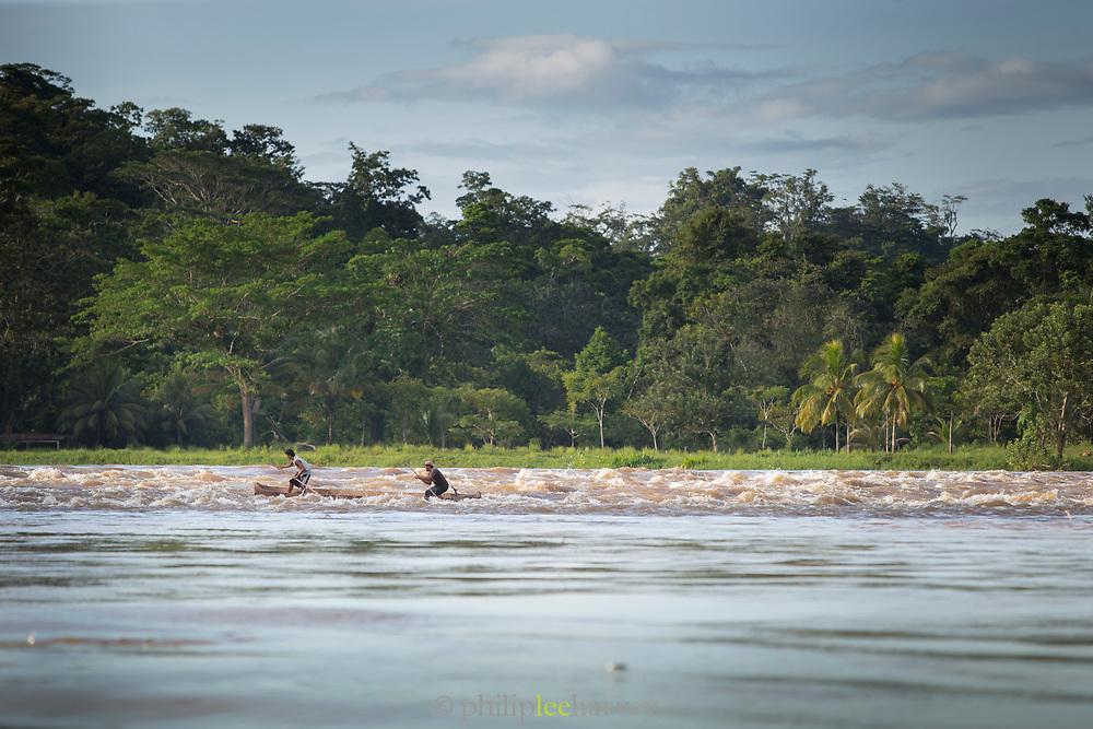 Two fishermen in boat in the San Juan river, El Castillo, Rio San Juan Department, Nicaragua