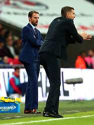 England Manager Gareth Southgate looks on as an animated Slovenia head coach Srecko Katanec encourages his players - Mandatory by-line: Robbie Stephenson/JMP - 05/10/2017 - FOOTBALL - Wembley Stadium - London, United Kingdom - England v Slovenia - World Cup qualifier