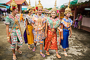 """29 SEPTEMBER 2012 - NAKORN NAYOK, THAILAND:  Thai dancers walk through the temple courtyard during observances of Ganesh Ustav at Wat Utthayan Ganesh, a temple dedicated to Ganesh in Nakorn Nayok, about three hours from Bangkok. Many Thai Buddhists incorporate Hindu elements, including worship of Ganesh into their spiritual life. Ganesha Chaturthi also known as Vinayaka Chaturthi, is the Hindu festival celebrated on the day of the re-birth of Lord Ganesha, the son of Shiva and Parvati. The festival, also known as Ganeshotsav (""""festival of Ganesha"""") is observed in the Hindu calendar month of Bhaadrapada, starting on the the fourth day of the waxing moon. The festival lasts for 10 days, ending on the fourteenth day of the waxing moon. Outside India, it is celebrated widely in Nepal and by Hindus in the United States, Canada, Mauritius, Singapore, Thailand, Cambodia, Burma , Fiji and Trinidad & Tobago.     PHOTO BY JACK KURTZ"""