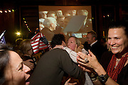 Elated US expatriate citizens celebrate Barack Obama's inauguration as the 44th US President in London. .