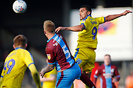 Wimbledon forward Kwesi Appiah (9) heads the ball on during the EFL Sky Bet League 1 match between Scunthorpe United and AFC Wimbledon at Glanford Park, Scunthorpe, England on 30 March 2019.
