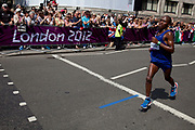 London, UK. Sunday 12th August 2012. Men's marathon competitors pass through the City of London, the last of the track and field competitions in the London 2012 Olympics.