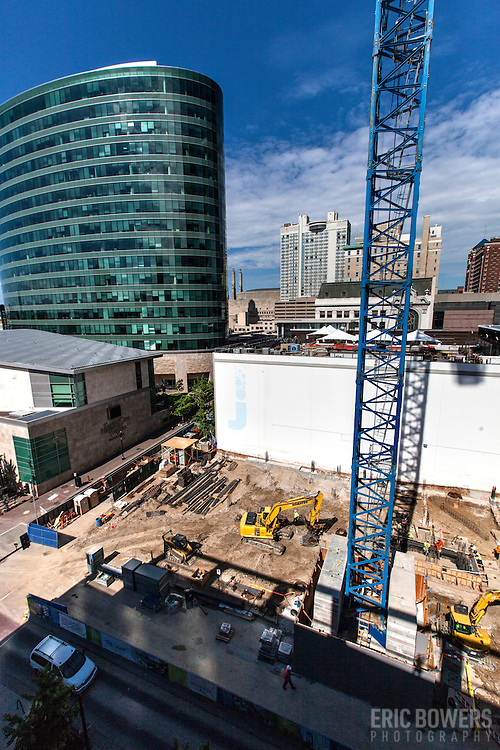 Early construction progress (May 30, 2014) on the One Light Tower at 13th & Walnut Streets,  downtown Kansas City, Missouri. The first planned new-built residential component to the Cordish Company's Power and Light District. Humphreys and Partners Architects, Kushner Companies, co-developer. JE Dunn Construction, general contractor.
