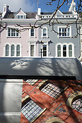 The design on the rear doors of a bespoke window companys van and Victorian houses along Elgin Crescent W11 in Notting Hill, on 13th March 2018, in London, England. Elgin Crescents houses were built in the 1850s and 1860s with many now listed buildings. East of Ladbroke Grove, it was originally called Elgin Road. It is named after the town of Elgin in Scotland.