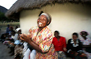 Zimbabwe04:A woman dances during a gathering of MDC supporters in Rukweza village,Manicaland to hear prospective MDC candidate Piesha speak to them.<br /> <br /> pic:Paul Hackett  sty:Christina Lamb