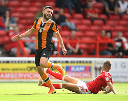 Robert Snodgrass of Hull City (L) is tackled by Jorge Grant of Nottingham Forest - Mandatory by-line: Jack Phillips/JMP - 30/07/2016 - FOOTBALL - The City Ground - Nottingham, England - Nottingham Forest v Hull City - Pre-Season Friendly