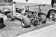 New Zealander Bruce MaClaren's car (front) being prepared in the  the pits next to Denis Hulme's car before the training session during the 1969 Spanish Grand Prix at the Montjuïc urban circuit in Barcelona, Spain.