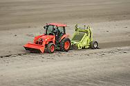 Mechanical beach cleaning, Looe Cornwall.