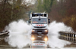 04 February 2021. Le Blanc Pignon, Pas de Calais, France.<br /> A garbage truck from CA2BM drives through record flooding from the Canche river which inundated roads surrounding the town of Le Blanc Pignon in Pas de Calais in north western France.<br /> Photo©; Charlie Varley/varleypix.com<br /> All rights managed.