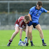 St. Joseph's Doora-Barefield's Peter Collins is tackled by Kildysart's Seamus Casey