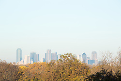View of downtown Dallas skyline from Piedmont Ridge looking over Great Trinity Forest in fall color, Dallas, Texas, USA