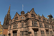 The Council House and the spire of Coventry Cathedral in the UK City of Culture 2021 on 23rd June 2021 in Coventry, United Kingdom. The Council House, Coventry is a Tudor Revival style civic building which acts as the meeting place of Coventry City Council and was built in the early 20th century. It is a Grade II-listed building. The UK City of Culture is a designation given to a city in the United Kingdom for a period of one year. The aim of the initiative, which is administered by the Department for Digital, Culture, Media and Sport. Coventry is a city which is under a large scale and current regeneration.