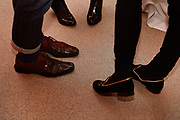 Feet of young people chatting at office party