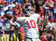 KANSAS CITY, MO - SEPTEMBER 29:  Quarterback Eli Manning #10 of the New York Giants throws a 69-yard touchdown pass against the Kansas City Chiefs during the first half on September 29, 2013 at Arrowhead Stadium in Kansas City, Missouri.  (Photo by Peter Aiken/Getty Images) *** Local Caption *** Eli Manning