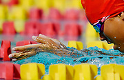 A swimmer competes during a meet between Pasadena City College and Chaffey College at the Pasadena Community College Aquatic Center on March 6, 2020 in Pasadena, California.