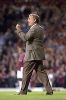 Photo. Glyn Thomas<br />West Ham Utd v Bradford City. Nationwide Division 1.<br />Upton Park, West Ham, London. 26/08/2003.<br />Caretaker manager Trevor Brooking celebrates his side's first half goal, scored by Jermaine Defoe.