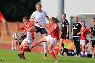 Loren Dykes (3) and Kayleigh Green (9) tackle Lisa -Marie Karlseng Utland (15).  Wales Women v Norway Women, Women's Euro 2017  Qualifying, group 8 match at the Newport Stadium in Newport, South Wales on Tuesday 7th June 2016. pic by  Andrew Orchard, Andrew Orchard sports photography.