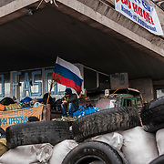 A separatist mans barricades surrounding the regional government building in Donetsk.