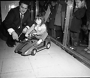 Electric Car Race at Supermarkets.<br /> 1971.<br /> 30.10.1971.<br /> 10.30.1971.<br /> 30th October 1971.<br /> Elect car races were held in Powers Supermarkets in Stillorgan,Blackrock Co Dublin and in Bray Co Wicklow.<br /> <br /> Picture shows four year old Celine Cahill of Ranelagh ,Dublin receiving last minute instruction before she set off.
