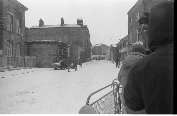 Peter Robinson At Special Criminal Court.  (R48)..1987..13.01.1987..01.13.1987..13th January 1987..Following a masked incursion into Clontibret, Co Monaghan,Ulster politician Peter Robinson and two others were charged by the police. The incursion was to highlight Unionist opposition to the Anglo Irish Agreement. As a result Mr Robinson faced the Special Criminal Court In Dublin. Mr Robinson was convicted for unlawful assembly and fined £17,500. Charges relating to assault on Gardai and malicious damages were dropped. Afterwards Mr Robinson said that he was thankful to the court for not imposing a custodial sentence...Picture shows special branch detectives taking up position outside the Special Criminal Court. Image also shows the media in attendance.