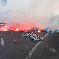 VENICE, ITALY - JUNE 06:  Smoke bombs  are tyres are set on fire in front of Venice Touristic Port on June 6, 2014 in Venice, Italy. Todays protest was to highlight one again the problem of the big cruise ships in Venice and the major works as the MOSE, TAV or Expo 2015.  (Photo by Marco Secchi/Getty Images)