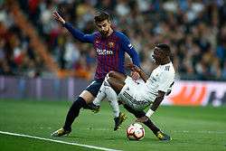 March 2, 2019 - Madrid, MADRID, SPAIN - Gerard Pique of FC Barcelona and Vinicius Jr of Real Madrid during the spanish league, La Liga, football match played between Real Madrid and FC Barcelona at Santiago Bernabeu Stadium in Madrid, Spain, on March 02, 2019. (Credit Image: © AFP7 via ZUMA Wire)