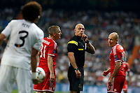 Real Madrid's Pepe and FC Bayern Munchen´s Bastian Schwestaeiger and Arjen Robben and Referee Howard Webb during Champions League soccer match Real Madrid v FC Bayern Munchen at Santiago Bernabeu stadium in Madrid, Spain. April 24, 2014. (ALTERPHOTOS/Caro Marin)