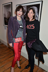 Left to right, JASMINE GUINNESS and MARY McCARTNEY at a private view of Chris Stein/Negative: Me, Blondie And The Advent Of Punk, held at Somerset House, The Strand, London on 5th November 2014.