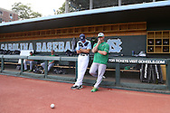 16 May 2016: Notre Dame pitching coach Chuck Ristano (right) talks with UNC counterpart Scott Forbes (left). The University of North Carolina Tar Heels hosted the University of Notre Dame Fighting Irish in an NCAA Division I Men's baseball game at Boshamer Stadium in Chapel Hill, North Carolina.