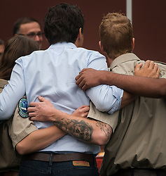 British Columbia Wildfire Service staff members put their arms around Prime Minister Justin Trudeau as he poses for a photograph with during a visit to the Prince George Fire Centre, in Prince George, B.C., on Thursday August 23, 2018. Photo by Darryl Dyck/CP/ABACAPRESS.COM
