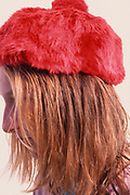 A792X9 Young blonde pretty girl wearing soft red hat