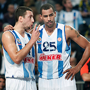 Fenerbahce Ulker's Roko Ukic (L) and Thabo Sefolosha (R) during their Euroleague Basketball Game 7 match Fenerbahce Ulker between Olympiacos at Sinan Erdem Arena in Istanbul, Turkey, Thursday, December 01, 2011. Photo by TURKPIX