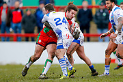 Keighley Cougars prop Samir Tahraoui (27) is tackled by Workington Town hooker Sean Penkywicz (24)  during the Betfred League 1 match between Keighley Cougars and Workington Town at Cougar Park, Keighley, United Kingdom on 18 February 2018. Picture by Simon Davies.
