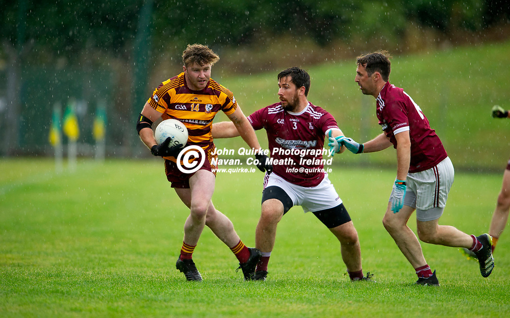 27-07-21. Carnaross v St. Vincent's Tailteann Cup Final 2020.<br /> Niall McDonnell, Carnaross side stepping St. Vincent's David Tallon's Challenge in the Meath Tailteann Cup Final 2020.<br /> Photo: John Quirke / www.quirke.ie<br /> ©John Quirke Photography, 16 Proudstown Road, Navan. Co. Meath. (info@quirke.ie / 046-9028461 / 087-2579454).