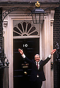 Prime Minister, John Major celebrates at the door of 10 Downing Street, returning to power after his re-election after replacing Margaret Thatcher, on 10th April 1992, in London England. Major's win was the fourth consecutive victory for the Conservative Party although it was its last outright win until 2015 after Labour's 1997 win for Tony Blair.